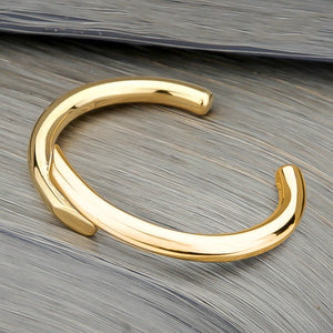 Gold harmony cuff bracelet viewed from its side