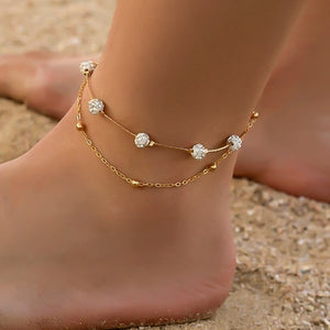 Gold layered crystal anklet on a womans ankle