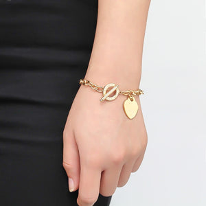 Gold love heart chain bracelet on a woman's wrist