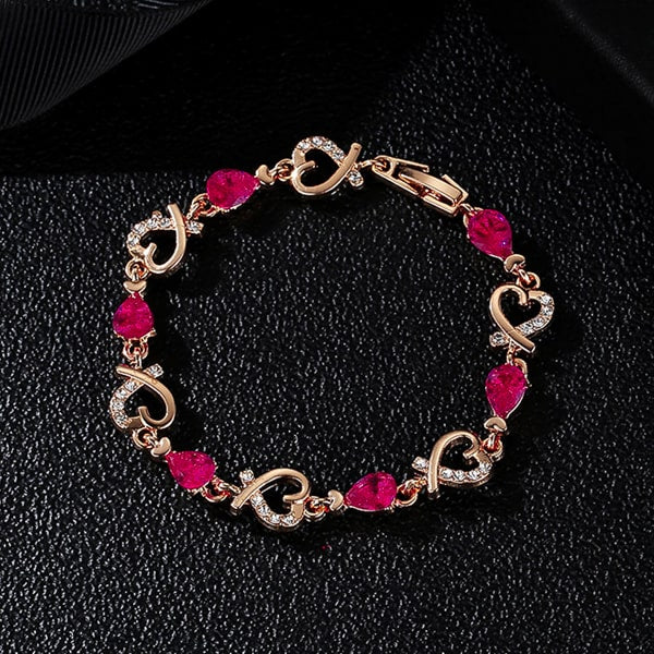 Gold heart chain bracelet with purple crystals details