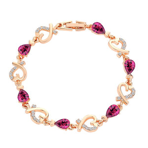 Gold heart chain bracelet with purple crystals