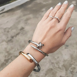 Gold & silver harmony cuff bracelet displayed on a woman's wrist