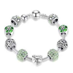 Green love charm bracelet with heart, flower, butterfly charms and green cubic zirconia
