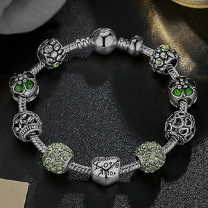 Green charm bracelet with snake chain