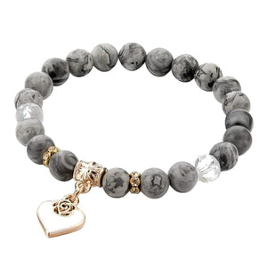 Beaded grey onyx bracelet with a gold heart charm