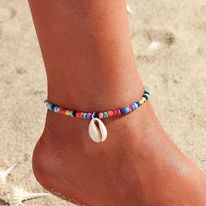 Multicolor beaded seashell anklet on a womans ankle