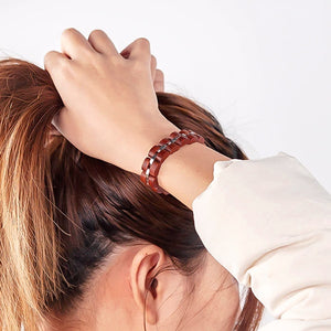 Natural rosewood bracelet on a woman's wrist