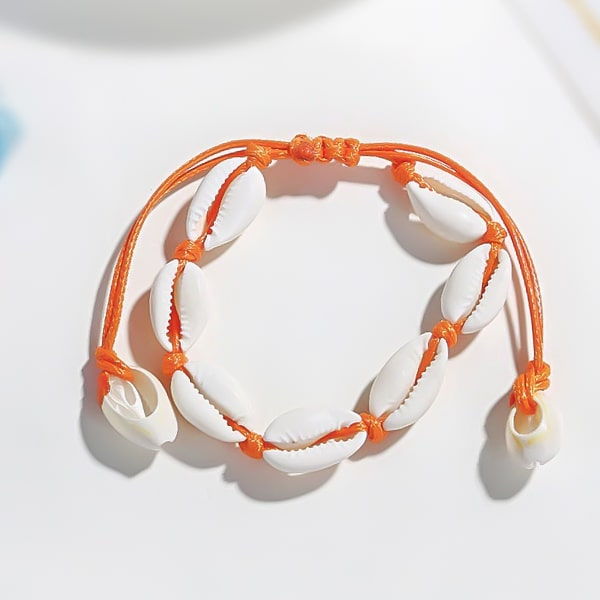 Orange cowrie shell ankle bracelet detailed close up