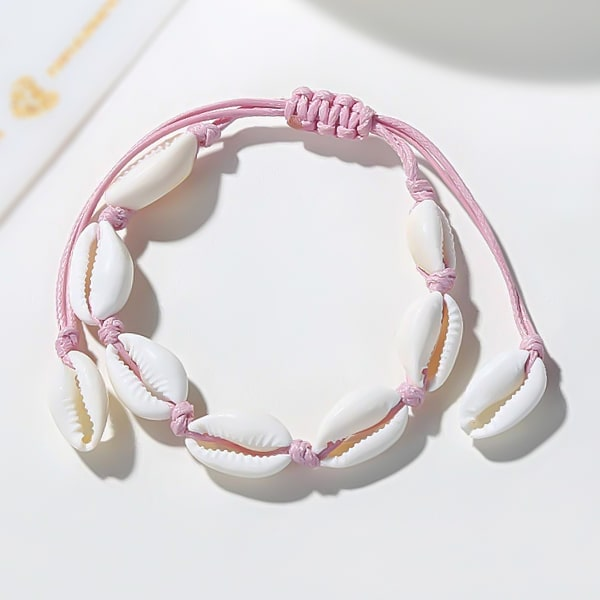 Pink cowrie shell ankle bracelet detailed close up