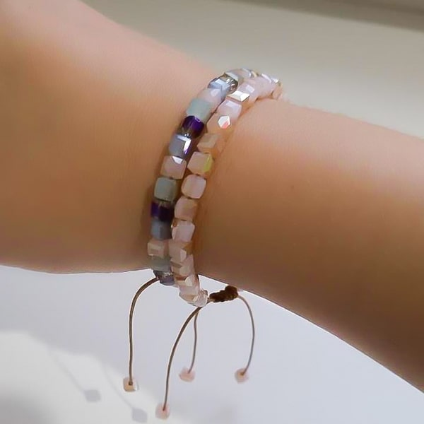 Woman wearing a powder pink square crystal bracelet