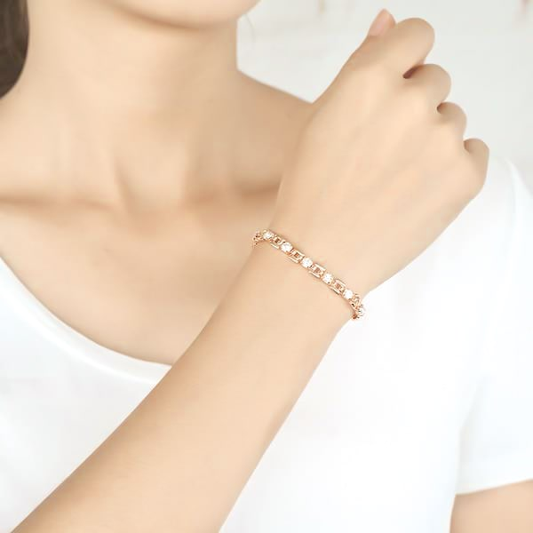 Woman wearing a clear and rose gold crystal bracelet
