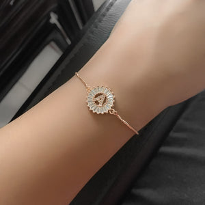 Woman wearing a rose gold crystal initial bracelet