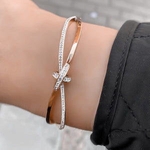Woman wearing a rose gold crystal knot bracelet