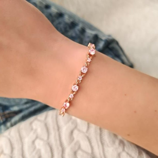 Woman wearing a rose gold pink crystal chain bracelet