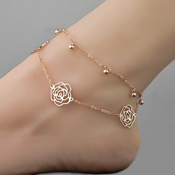 Woman wearing a rose gold rose flower anklet