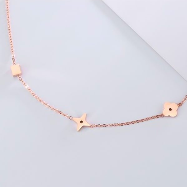 Closeup image of the rose gold lucky charm anklet