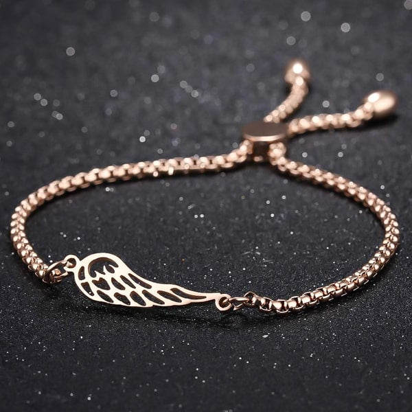 Rose gold angel wing bracelet close up details