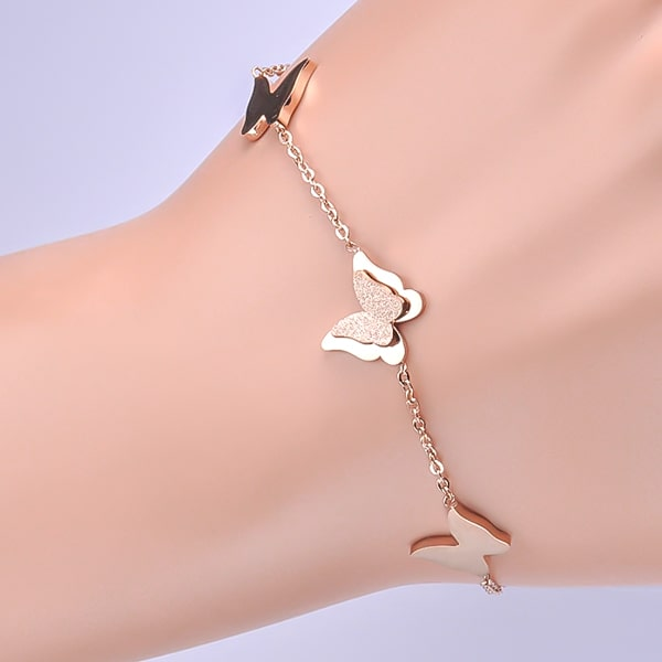 Rose gold butterfly bracelet displayed on a woman's wrist