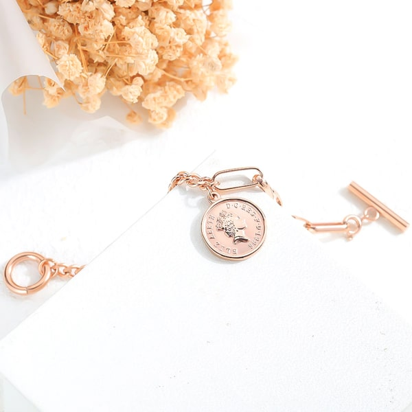 Rose gold coin and dual chain bracelet close up details