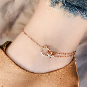 Rose gold crystal roman numeral anklet on an ankle