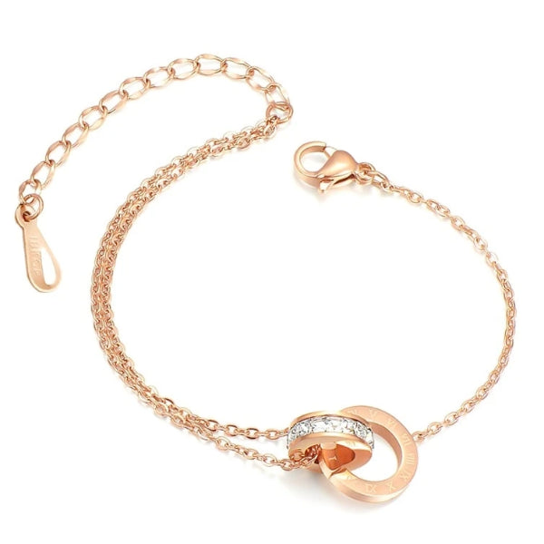 Rose gold anklet with two interlocked rings - one with roman numerals and one with crystals