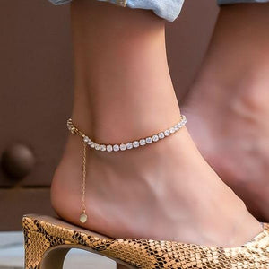 Rose gold crystal tennis anklet displayed on a womans ankle