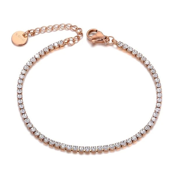 Rose gold crystal tennis anklet on a white background