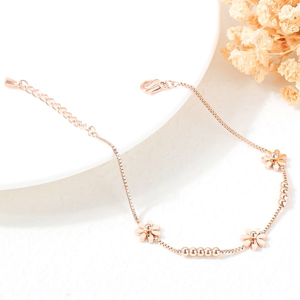 Rose gold daisy flower bracelet close up details