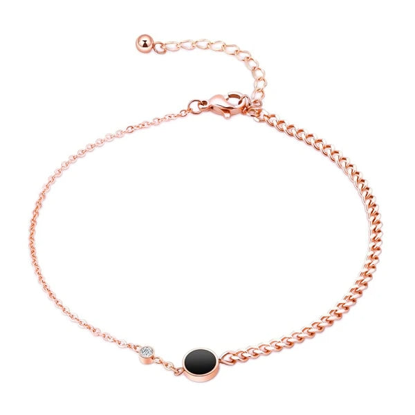 Rose gold elegant crystal anklet with a black and clear crystal