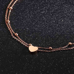 Rose gold layered beads and heart ankle bracelet close details