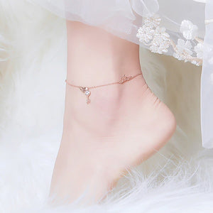 Rose gold 10K vermeil love anklet with a heart and a key pendant displayed on a womans ankle