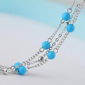 Turquoise beads on a silver chain anklet