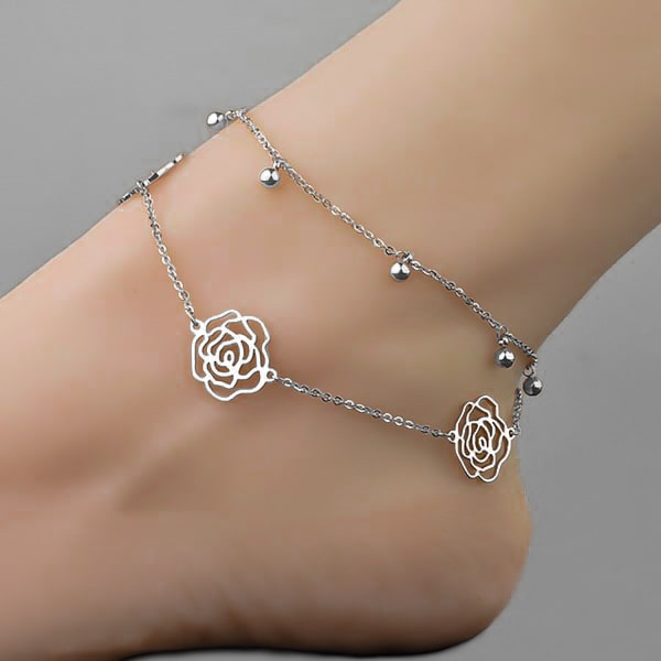 Woman wearing a silver rose flower anklet