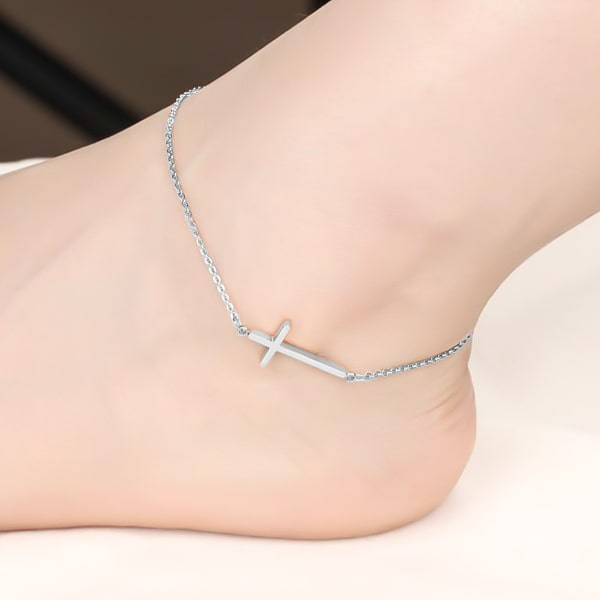 Silver cross anklet on a womans ankle