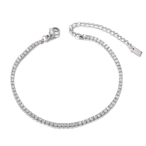 Silver crystal tennis anklet on a white background