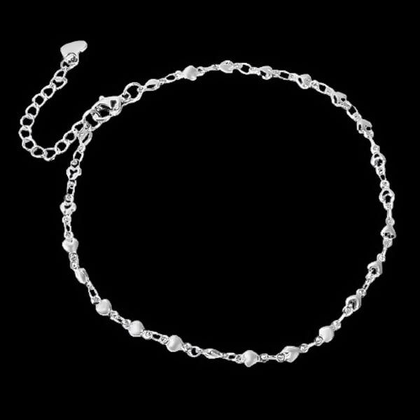 Silver heart chain anklet on a dark background