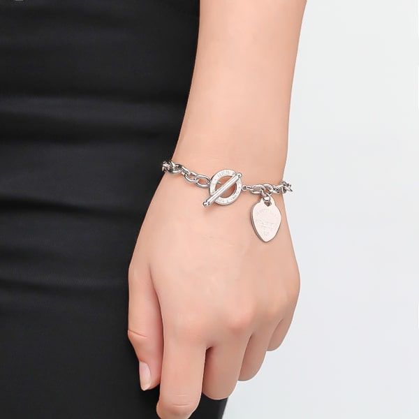 Silver love heart chain bracelet on a woman's wrist