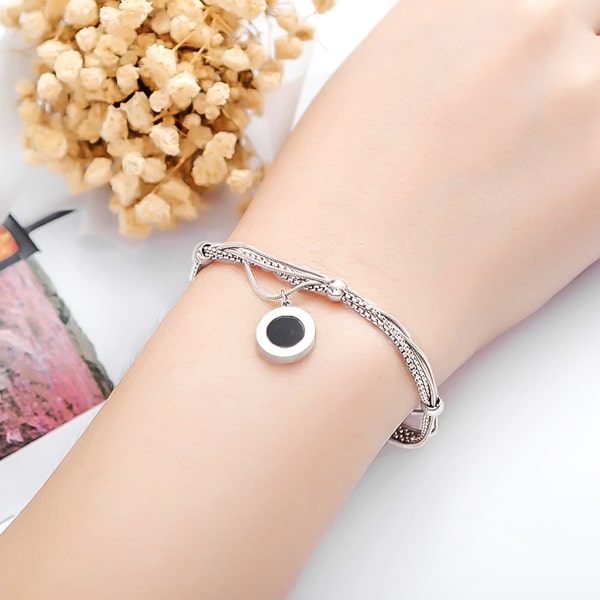 Silver Roman multilayer Numeral Bracelet on a woman's wrist