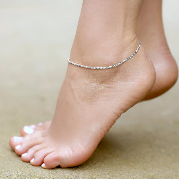 Silver rope chain anklet displayed on a womans ankle