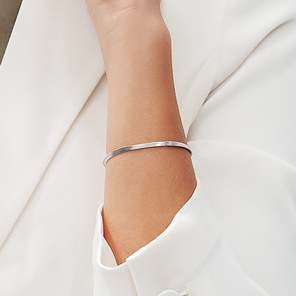 Silver snake chain bracelet on a woman's wrist