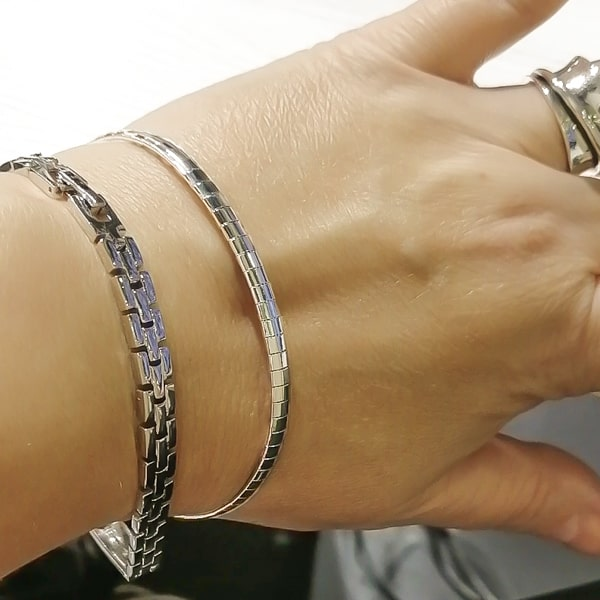 Silver square chain bracelet displayed on a woman's wrist