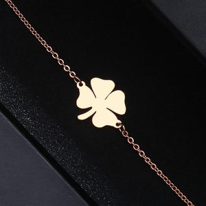 Simple rose gold lucky bracelet with a four-leaf clover charm