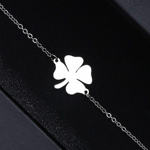 Simple silver lucky bracelet with a four-leaf clover charm