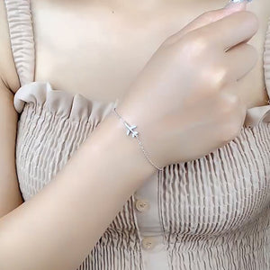 Sterling silver airplane bracelet on a woman's wrist