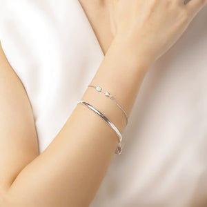 Sterling silver arrow bracelet on a woman's wrist