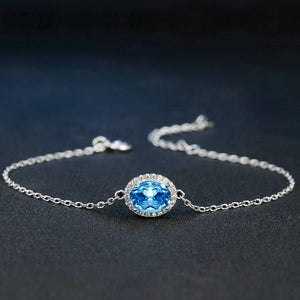 Sterling silver bracelet with a blue oval cut topaz details