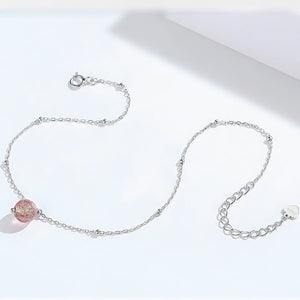 Close details of the sterling silver anklet with a red fire quartz crystal
