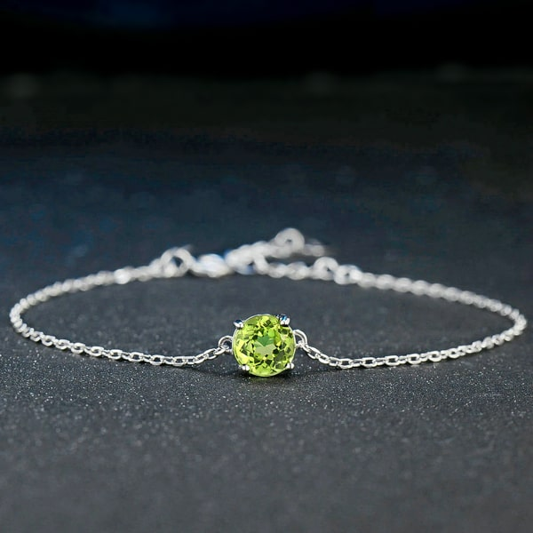 Sterling silver round-cut peridot bracelet close up