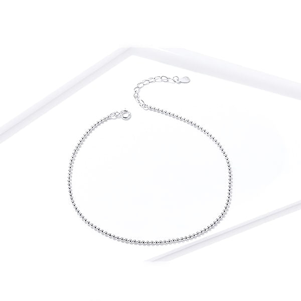 Sterling silver simple beaded ankle bracelet on a white background