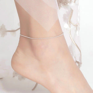 Silver simple beaded anklet on a womans ankle